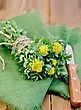 Rhodiola Rosea Flowers, Tied With String With A Knife On A Green Napkin On A Background Of Wooden Boards