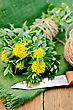 Rhodiola Rosea Flowers Tied With Twine, Ball Of Twine, Knife On Green Napkin On The Background Of Wooden Boards