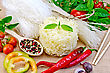 Rice Noodles Are Different, Tomatoes, Peppers, Chopsticks, Garlic, Basil On A Background Of Sack Cloth stock photography