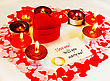 Ring And A Card With Marriage Proposal With Burning Candles. Shallow Depth Of Field. stock photography