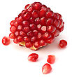 Skin Ripe Pomegranate Piece Isolated On White Background stock photo