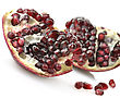 Ripe Pomegranate With Red Seeds On White Background ,Close Up stock photo