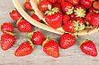Ripe Strawberry In Wicker Basket On A Wooden Background stock image