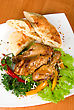 Roasted Chicken Drumstick Garnished With Fresh Green Salad, Pepper And Greens