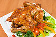 Fat Roasted Chicken Garnished With Fresh Tomatoes, Green Salad, Pepper And Greens stock photo