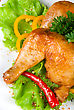 Roasted Chicken Ham Garnished With Fresh Green Salad, Pepper And Greens stock photography