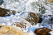 Rocks In Sea Water Foam stock photography