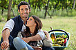 Winemaking Romantic Man And Woman Picking Grapes And Drinking Wine stock photography