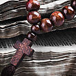 Rosary With A Wooden Cross Lying On Open Bible stock image