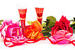 Roses, Candles, Red Ribbon And Two Glasses Isolated On White Background