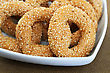 Round Rusks With Sesame Seeads In White Bowl