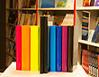 Row Of Colorful Books And Electronic Book Reader In The Book Shop