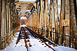 Rusty Bridge And Abandoned Railroad Tracks In Winter stock image