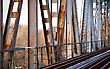 Way Rusty Old Bridge And Abandoned Railroad Tracks stock photo
