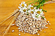 Rye Flakes, A Bouquet Of Daisies And Stalks Of Rye On A Wooden Board stock photo