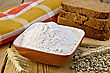 Rye Flour In A Bowl, Homemade Loaves Of Rye Bread, Spikelets And Grain Of Rye, Napkin On Wooden Board stock image