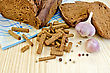 Rye Homemade Bread, Crackers, Garlic, Pepper Peas, Blue Cloth On A Background Of Wooden Boards stock photo