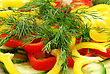 Salad Of Cutter Red And Yellow Pepper, Cucumber And Dill Closeup stock photo