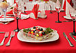 Colored Salad Of Fresh Vegetables, Served On The Table. Style Tricolor - Red, White, Black stock photo