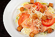 Salad Of Lettuce, Chinese Cabbage, Tomato, Garlic Rusk, Parmesan Cheese, Sauce And Smoked Salmon Filet