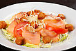 Salad Of Lettuce, Chinese Cabbage, Tomato, Garlic Rusk, Parmesan Cheese, Sauce And Smoked Salmon Filet stock photo