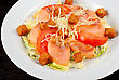 Meal Salad Of Lettuce, Chinese Cabbage, Tomato, Garlic Rusk, Parmesan Cheese, Sauce And Smoked Salmon Filet stock photo