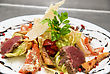 Restaurant Salad With Roast Beef, Chinese Cabbage, Parmesan Cheese, Courgette, Pepper And Tomato stock photography