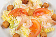 Salad Of Tiger Shrimps, Lettuce, Chinese Cabbage, Tomato, Garlic Rusk, Parmesan Cheese And Sauce stock photo