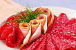Salami And Bacon On Plate Isolated On Kitchen Towels Background