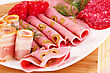 Appetizers Salami, Mortadella And Bacon On Plate On Wooden Board stock photography