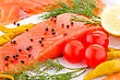 Salmon Fillet With Lemon, Dill, Pepper, Tomatoes On Plate stock image