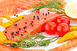 Fishfood Salmon Fillet With Lemon, Dill, Pepper, Tomatoes On Plate stock photography
