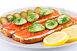 Salmon Sandwiches With Fresh And Pickled Cucumber And Lemon On Plate Closeup Image stock image