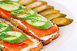 Salmon Sandwiches With Fresh And Pickled Cucumber On Plate Closeup Image stock photography