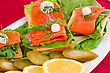 Salmon Sandwiches With Lettuce, Fresh And Pickled Cucumber, Onion, Lemon On Plate