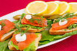 Salmon Sandwiches With Lettuce, Fresh And Pickled Cucumber, Onion, Lemon On Plate stock image