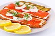 Spread Salmon Sandwiches With Pickled Cucumber, Onion, Dill And Lemon On Plate Closeup Image stock image