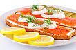 Salmon Sandwiches With Pickled Cucumber, Onion, Dill And Lemon On Plate Closeup Image stock photography