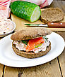 Sandwich Of Rye Bread With Cream, Cucumber, Dill And Salmon On A Plate On A Wooden Board stock photography