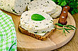 Sandwich On A Slice Of Rye Bread With Butter And Homemade Cheese, Basil, Knife, Napkin, Parsley On A Wooden Boards Background