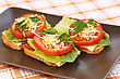 Sandwiches With Bacon, Lettuce, Tomato And Cheese On Plate stock photo