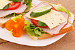Sandwiches With Rusks, Vegetables, Bacon And Cheese On Plate stock photography