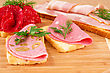 Sandwiches With Salami, Bacon And Mortadella On Wooden Board
