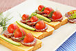 Sandwiches With Salami, Cheese, Cherry Tomato And Dill On Plate stock photography