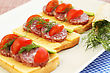 Sandwiches With Salami, Cheese, Cherry Tomato And Dill On Plate stock photo