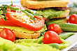 Sandwiches With Salami, Cheese, Cherry Tomato And Parsleyl On Plate stock image