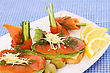 Sandwiches With Salmon, Cheese, Lettuce, Herbs On Plate, Olives And Lemons
