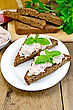 Sandwiches On Two Pieces Of Rye Bread With Cream Of Salmon And Mayonnaise, Basil, Napkin, Parsley On A Wooden Boards
