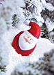 Santa Figurine In The Snow stock photo