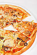 Seafood Pizza Closeup With Salmon Shrimps Tomato Pepper Olive And Mozzarella Cheese
